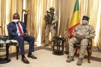 Kenya's Ambassador to the U.N. Martin Kimani, left, leading a United Nations Security Council mission, meets with Transition President Col. Assimi Goita, right, in Bamako, Mali, on Oct. 24, 2021. (AP Photo/Harandane Diko)