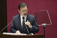 South Korea's President Moon Jae-in delivers a speech at the National Assembly in Seoul on Oct. 25, 2021. (Jung Yeon-je/Pool Photo via AP)