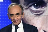 In this Sept.23, 2021 file photo, French far-right media pundit Eric Zemmour poses prior to a televised debate between French far-left leader, Jean-Luc Melenchon in Paris. (Bertrand Guay, Pool Photo via AP)