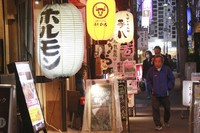 People walk at a street in Tokyo, Monday, Oct. 25, 2021. (AP Photo/Koji Sasahara)