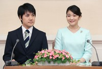 Princess Mako and Kei Komuro are seen in this file photo of a press conference to announce their unofficial engagement, at the Akasaka East Palace in Minato Ward, Tokyo, on Sept. 3, 2017. (Pool photo)