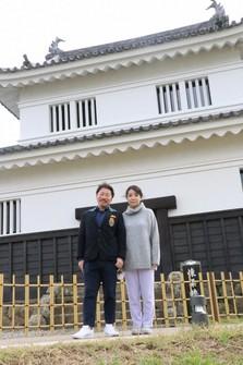 "Testusya Sanada and his wife are seen in front of Hirado Castle's ""Kaiju Yagura"" tower in the city of Hirado, Nagasaki Prefecture, on Oct. 24, 2021. (Mainichi/Hiroshi Watanuki)"