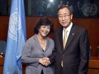 In this photo released by U.N. Photo, then U.S. Secretary-General Ban Ki-moon, right, poses with Noeleen Heyzer, then executive secretary of the Economic and Social Commission for Asia and the Pacific, for a photo after the two signed the 2009 Senior Management Compact Agreement, at U.N. headquarters on Feb. 12, 2009. (U.N. Photo via AP)