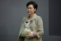 Hong Kong Chief Executive Carrie Lam wearing an arm brace after suffering fracture from fall at home, attends a press conference in Hong Kong, on Oct. 26, 2021. (AP Photo/Kin Cheung)