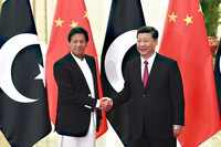 In this April 28, 2019, file photo, China's President Xi Jinping, right, shakes hands with Pakistan's Prime Minister Imran Khan before a meeting at the Great Hall of the People in Beijing. (Madoka Ikegami/Pool Photo via AP)