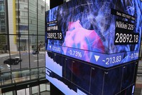 An electronic stock board shows Japan's benchmark Nikkei 225 at a conference hall in Tokyo, on Oct. 27, 2021. (AP Photo/Koji Sasahara)