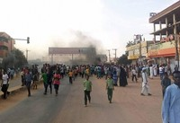 In this Oct. 25, 2021 photo, pro-democracy protesters take to the streets to condemn a takeover by military officials in Khartoum, Sudan. (AP Photo/Ashraf Idris)