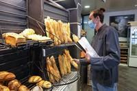 Baker Hugo Hardy prepares baguettes to be sold at Bigot bakery in Versailles, west of Paris, on Oct. 26, 2021. (AP Photo/Michel Euler)