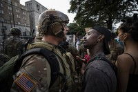 In this June 3, 2020, file photo, a demonstrator stares at a National Guard soldier as protests continue over the death of George Floyd, near the White House in Washington, D.C. (AP Photo/Alex Brandon)