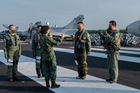 In this Sept. 15, 2021, file photo released by the Taiwan Presidential Office, Taiwanese President Tsai Ing-wen, center, speaks with military personnel near aircraft parked on a highway in Jiadong, Taiwan. (Taiwan Presidential Office via AP)