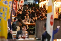 People gather at bars and restaurants later in the evening on Oct. 25, 2021, in Tokyo. (AP Photo/Kiichiro Sato)
