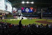 A fan waits for a fly ball during batting practice before Game 2 of baseball's World Series between the Houston Astros and the Atlanta Braves on Oct. 27, 2021, in Houston. (AP Photo/Ashley Landis)